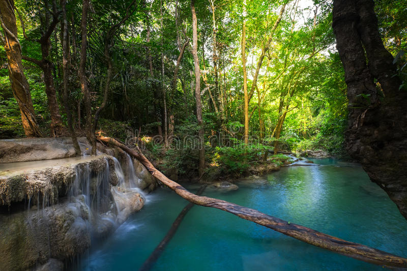 Jungle landscape with Erawan waterfall. Kanchanaburi, Thailand. Jungle landscape with flowing turquoise water of Erawan cascade waterfall at deep tropical rain royalty free stock photos