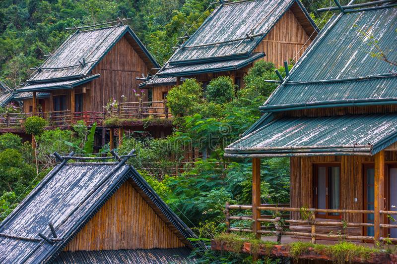 Wooden bamboo houses in the jungle. Sanya Li and Miao Village. H. The jungle is the most interesting thing that there is on the Sanya island for the traveler stock image