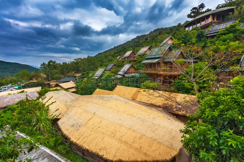 Wooden bamboo houses in the jungle. Sanya Li and Miao Village. H. The jungle is the most interesting thing that there is on the Sanya island for the traveler stock photo
