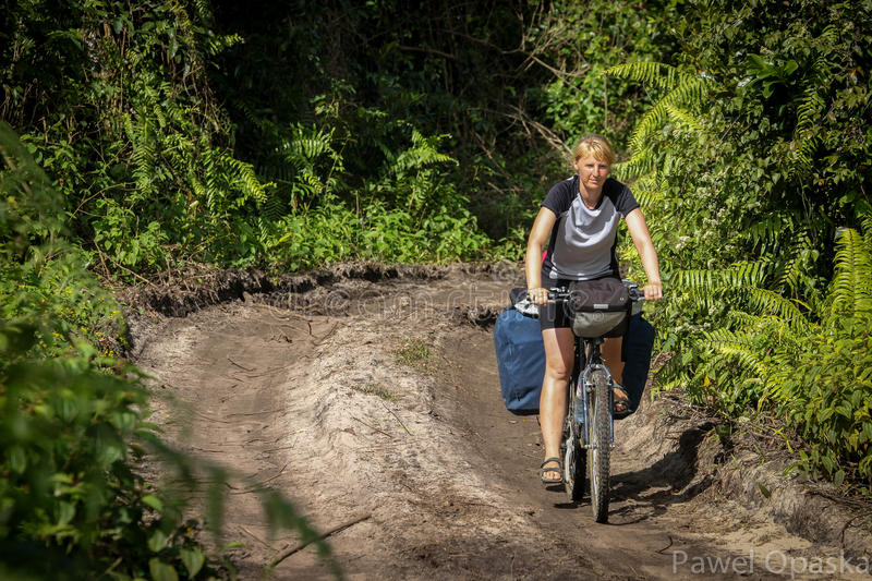 Download On the jungle road stock photo. Image of difficulty, cycle - 38681182