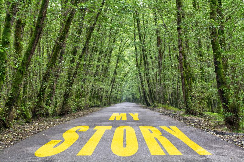 Jungle road to my story. My story word written on jungle road with tall tree two side, green road royalty free stock photos