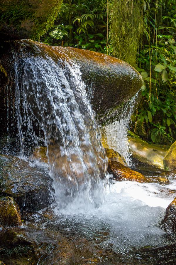 Jungle Waterfall In A Mountain River. Water Splashes Flowing From The Rocks. Beatiful Hiking Landscape Hiden In Tropical Rainforest In Brazil stock photos