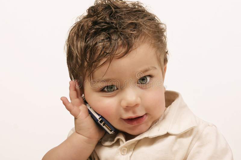 Junior with cellphone. Speaking with mum, dad, grandma, etc royalty free stock photos