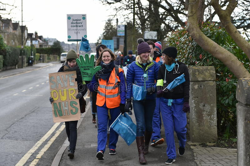 Junior Doctors Strike. BATH, UK - FEBRUARY 10, 2015: Junior doctors walk to a picket line at the Royal United Hospital. Junior NHS doctors across the country stock photography
