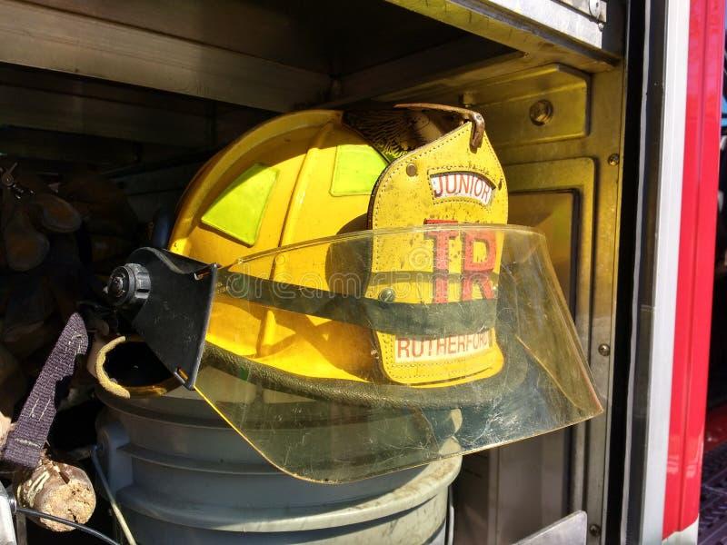 Bright Yellow Firefighter Helmet, Junior, Rutherford, NJ, USA stock image