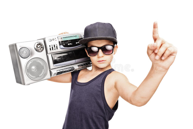 Junior rapper carrying a ghetto blaster and gesturing. With his hand isolated on white background royalty free stock photos
