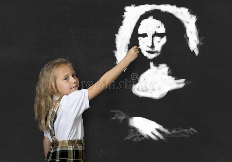 Junior schoolgirl with blonde hair drawing and painting with chalk La Gioconda amazing replica stock photography