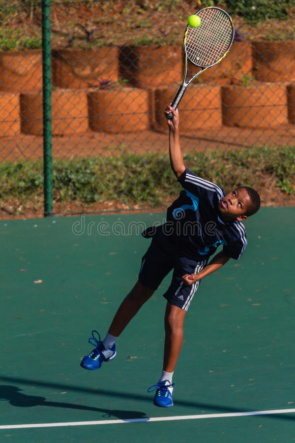 Junior Serve Hit Ball Tennis royalty free stock photos