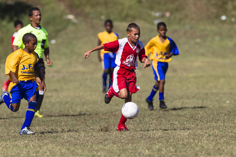 Download Junior Soccer Players Ball editorial stock photo. Image of kick - 28707783