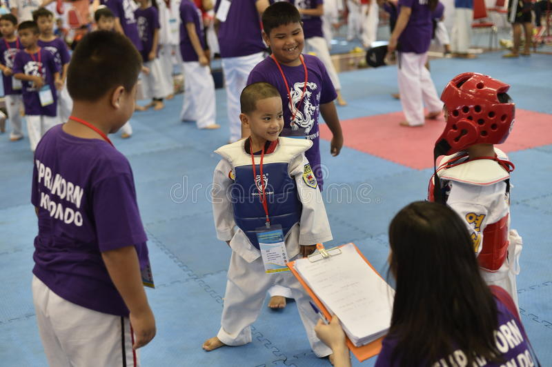 Junior Taekwondo competition. A Junior Taekwondo competition 1st round , Nakon Khonkhean's game at North-Eastern University ,Khonkhean Thailand 31st May 2015 royalty free stock photo