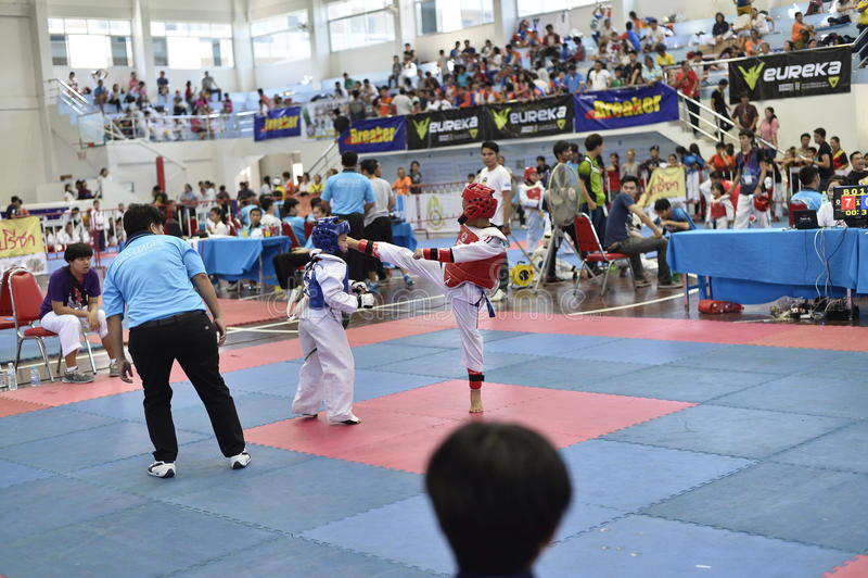 Junior Taekwondo competition. A Junior Taekwondo competition 1st round , Nakon Khonkhean's game at North-Eastern University ,Khonkhean Thailand 31st May 2015 stock photos
