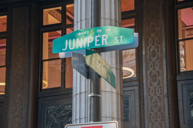 Juniper Street and South Penn Square street signs on pole in center city Philadelphia. Juniper Street and South Penn Square street signs on pole in center city stock photo
