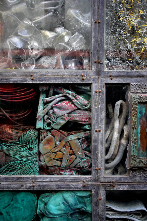 Junk behind glass stock images