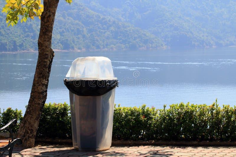 Junk, Bin, Garbage, Plastic waste bin clear trash sideways walk at riverside, Waste plastic bin on floor royalty free stock image