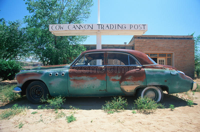 A junk car at the Cow Trading Post in Arizona stock photography