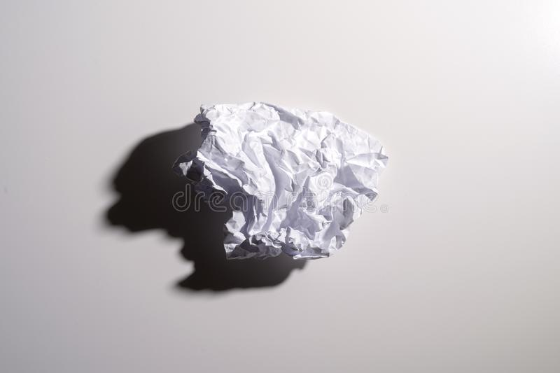 Junk or crumpled sheet of blank paper in ball shape isolated. On white background in business concept royalty free stock image