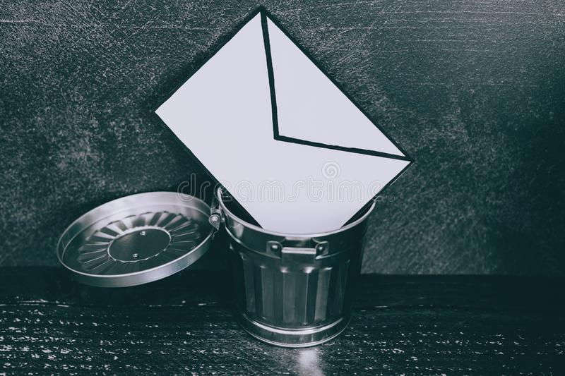 Junk email envelope going in the trash stock photo