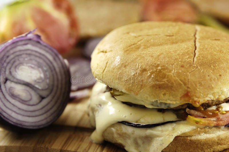 Junk food. Photo of junk food - hamburger on the table stock image