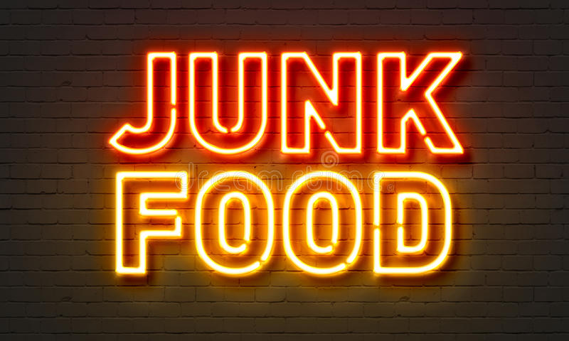 Junk food neon sign on brick wall background. Junk food neon sign on brick wall background stock photos