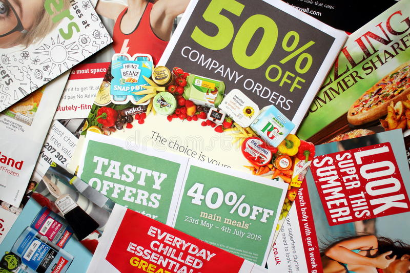 Junk Mail Delivery. LONDON, United Kingdom - JULY 25: Sample of junk mail items delivered to a private residence in England as advertising for local retail stock image
