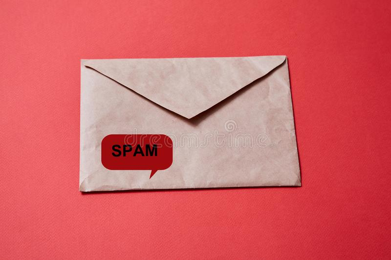 Junk mail or spam and fake letter idea. Concept for unsolicited mail or e-mail. Envelope on red background stock photos