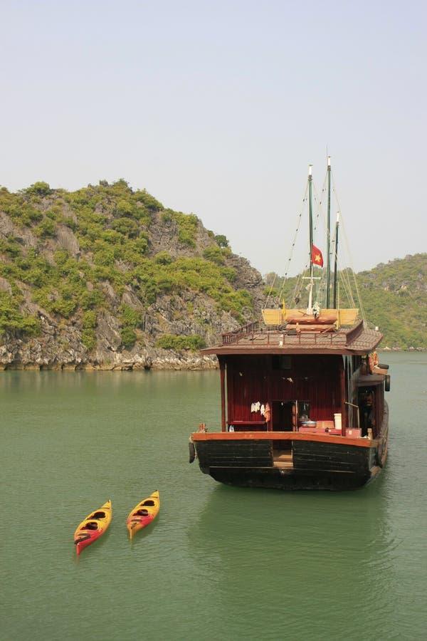 Free Junk Towing Kayaks, Halong Bay, Vietnam Stock Image - 26112631