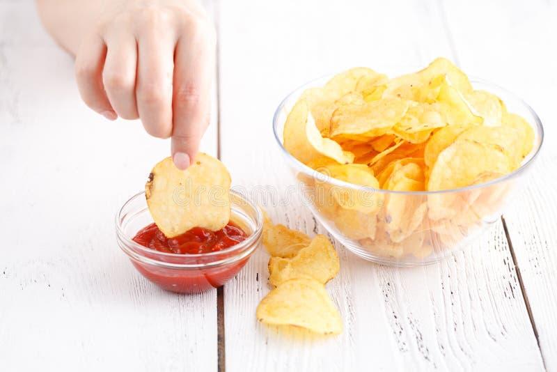 Junk unhealthy food, heap of potato chipa in big dish royalty free stock image