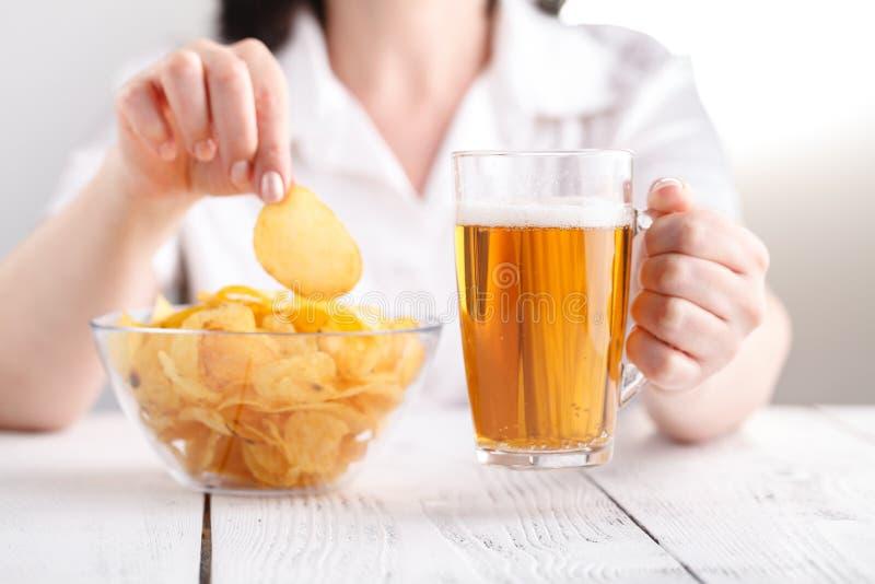 Junk unhealthy food, heap of potato chipa in big dish stock photography