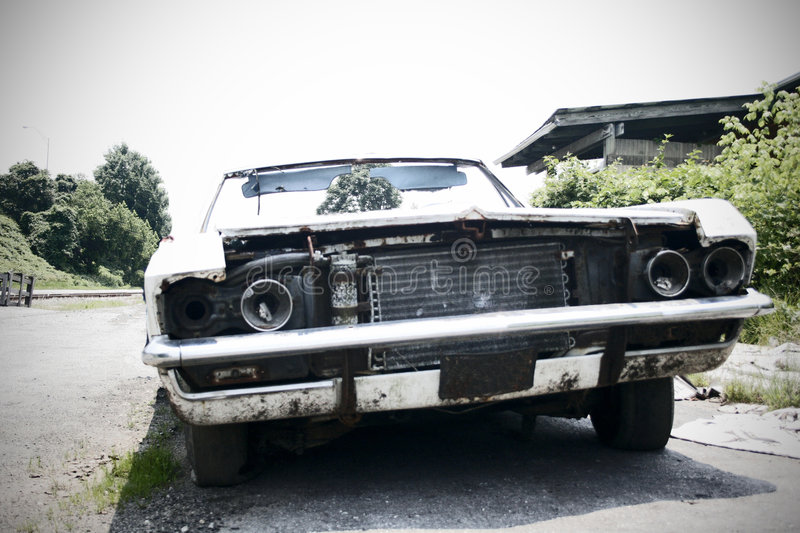 Junked Car - focus in the background stock images
