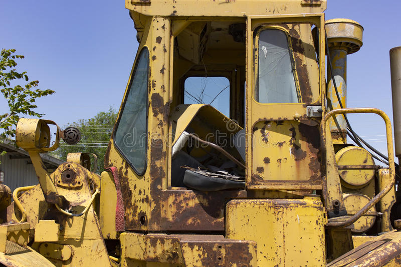 Junked, rusted heavy equipment closeup stock image