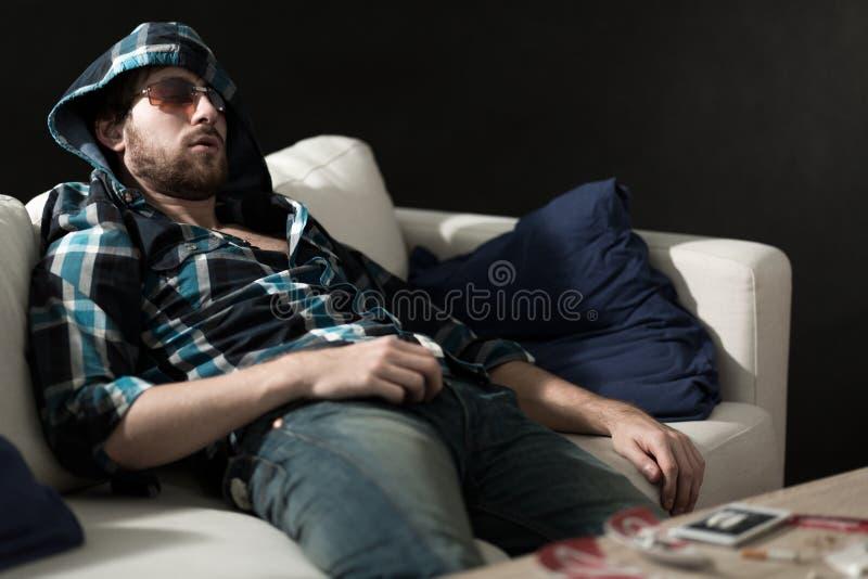 Junkie sleeping after drugs stock image