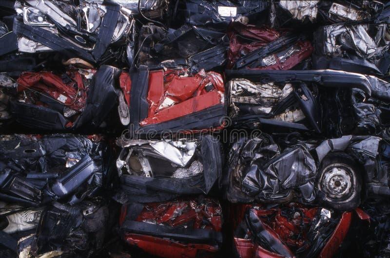 Junkyard. Crushed cars in a junkyard royalty free stock photo