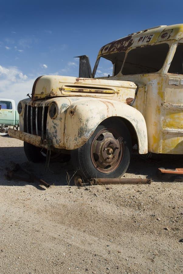 Junkyard Bus. A old dilapidated bus in a junkyard royalty free stock images