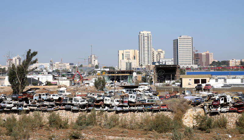 Junkyard on the outskirts of the city. BEER SHEVA, ISRAEL - DECEMBER 15, 2013: Dump old cars on the outskirts of the city royalty free stock photos