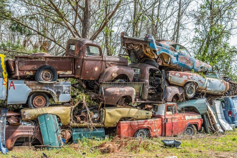 Junkyard pile up of old vintage vehicles stock image