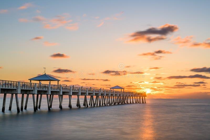 Juno, Florida, USA at the Juno Beach Pier. During sunrise stock image