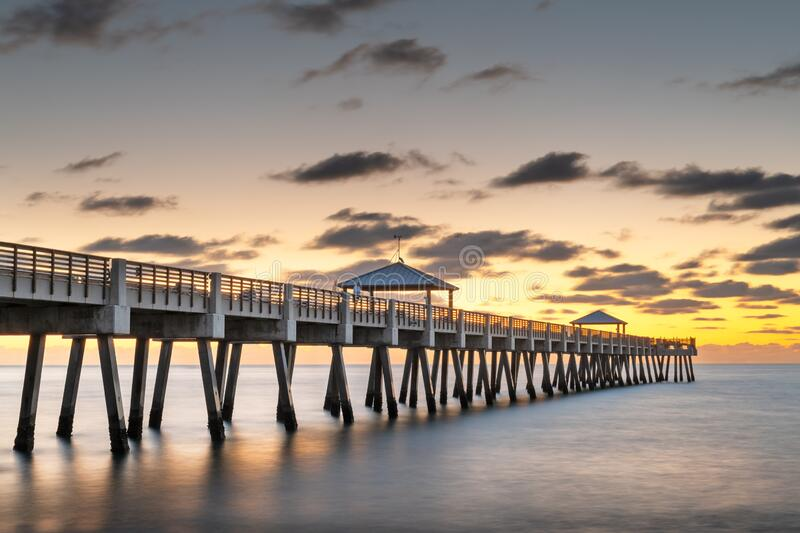 Juno, Florida, USA at the Juno Beach Pier. During sunrise stock photography