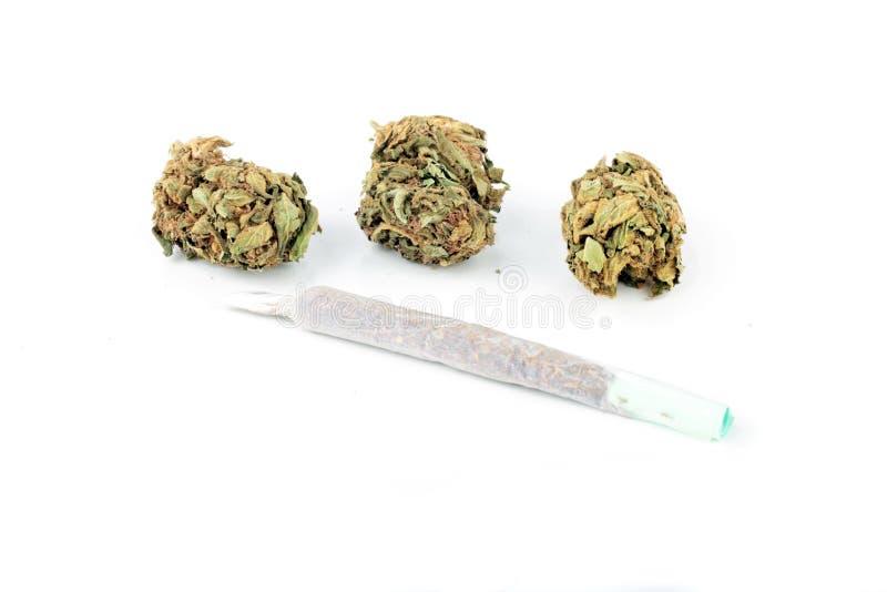 Junta de la marijuana con marijuana foto de archivo