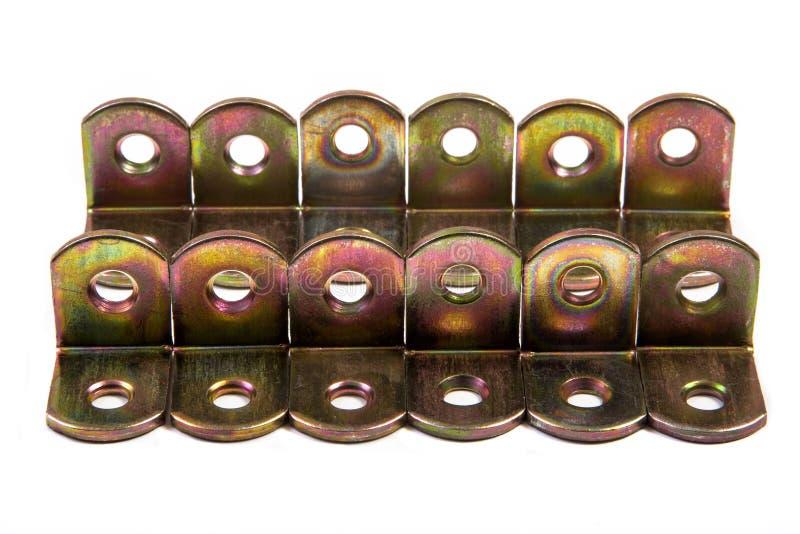 Juntas del metal En dos filas en un fondo blanco imágenes de archivo libres de regalías