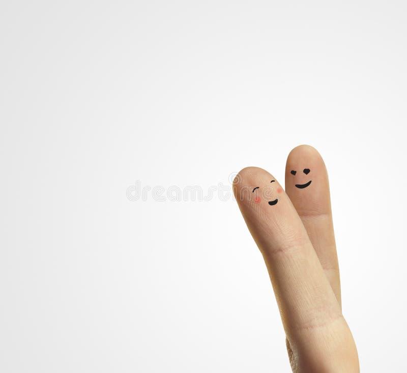 Junte el abrazo de los smiley felices de los dedos con amor fotos de archivo