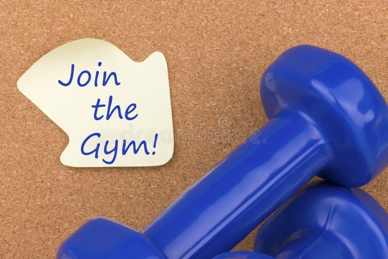 Junte-se ao Gym escrito na nota fotos de stock