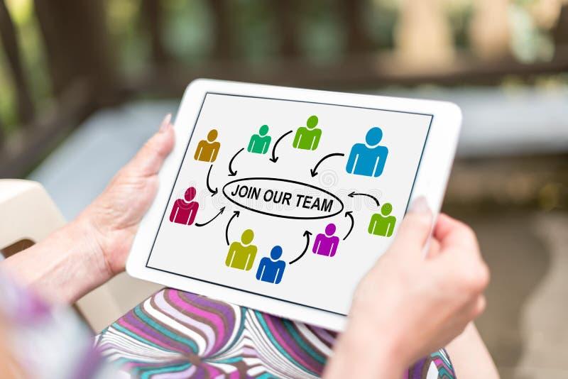Junte-se a nosso conceito da equipe em uma tabuleta fotografia de stock royalty free