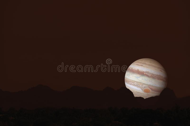 Jupiter silhouette mountain on cloud and night sky stock photo