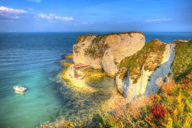 Jurassic kustkrita staplar gammal Harry Rocks Dorset England UK öst av Studland som en målning arkivbild