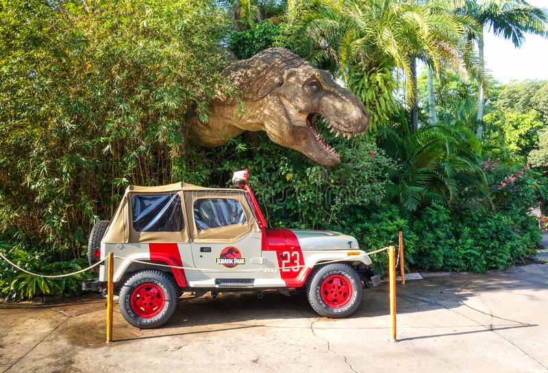 Jurassic Park jeep and Tyrannosaurus rex royalty free stock image