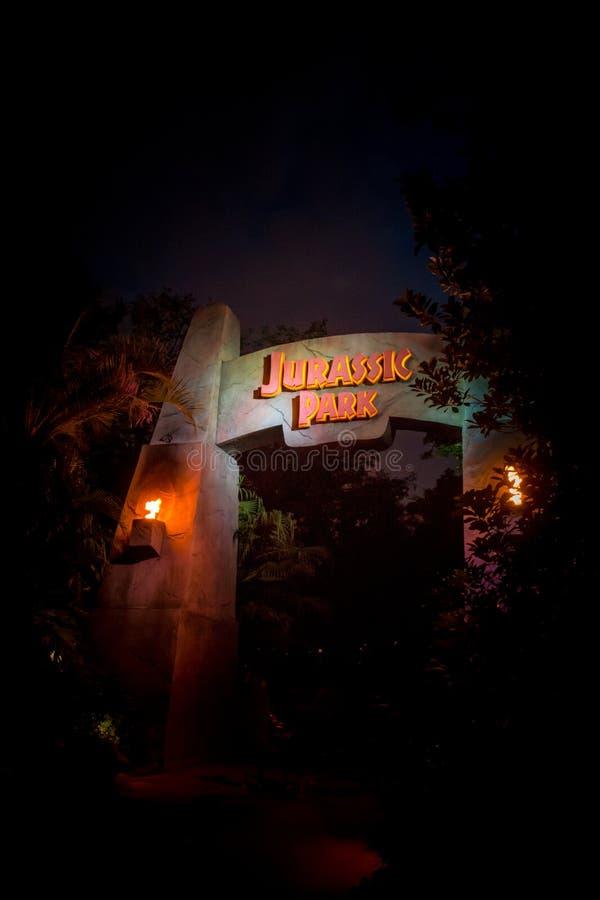Jurassic Park ride at night in Universal Orlando theme park. Entrance to the Jurassic park ride at Universal Orlando resort royalty free stock photo