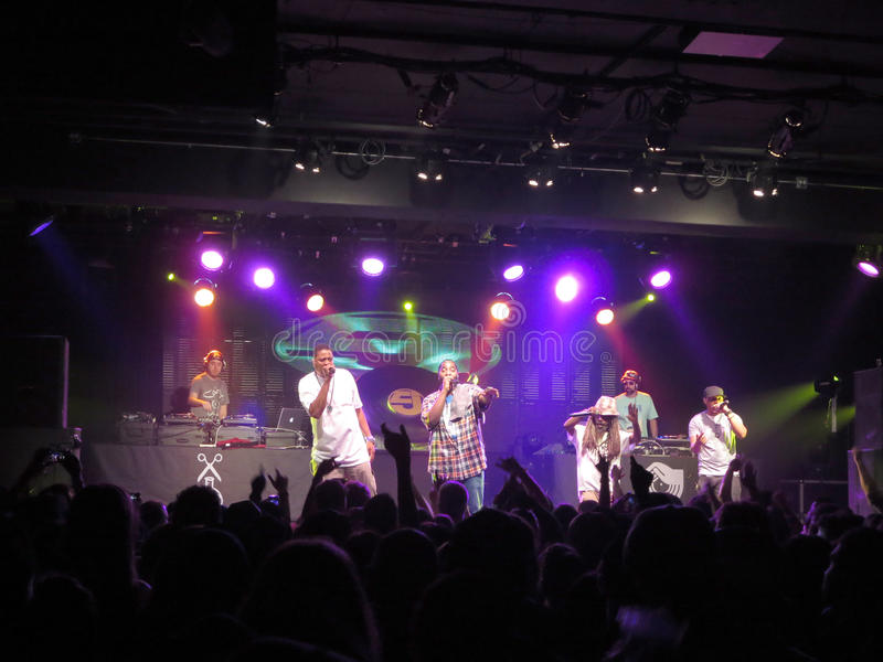 Jurassic 5 singers raps and DJ spin on stage as fans cheer royalty free stock photography