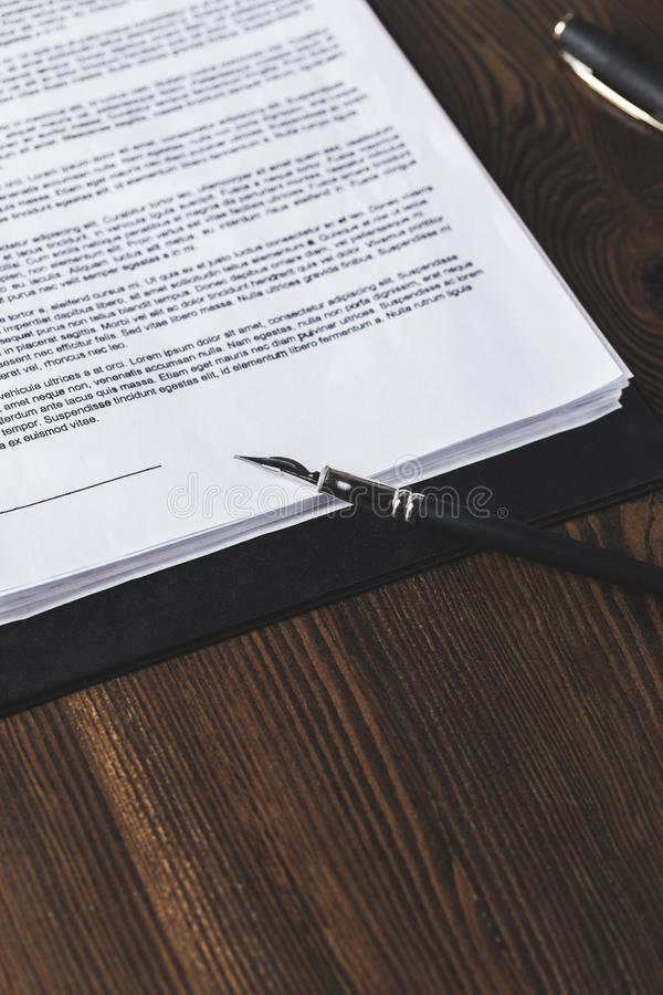 Juridical contract on wooden table with pen,. Law concept stock image
