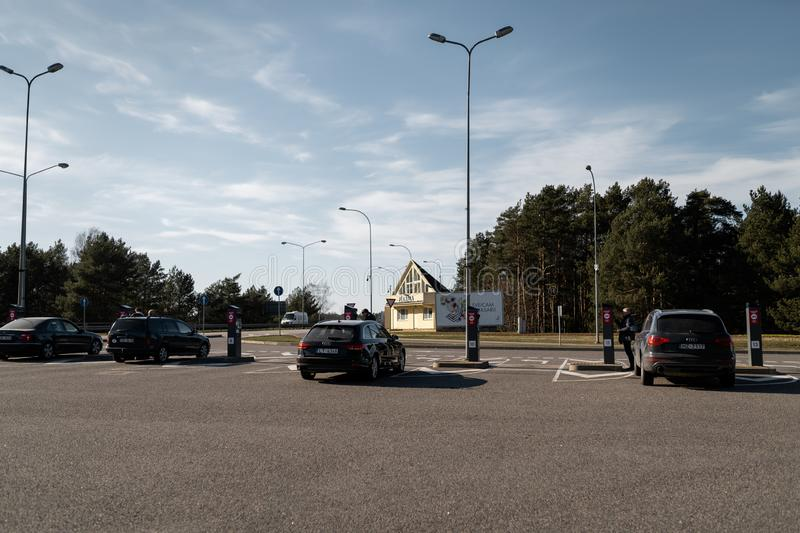 JURMALA, LATVIA - APRIL 2, 2019: People are paying 2 EUR to enter the city stock image