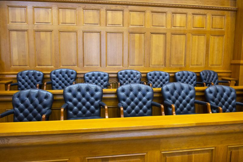 Jury Box, Law, Legal, Lawyer, Judge, Court Room. Jury box in a legal law court room. The courtroom is where you will find jurors and jurists, lawyer, judge stock photography